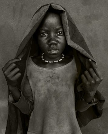 Orphaned Child, Namibia, 2012, giclee hybrid, 83 x 56 cm, signed in margin.