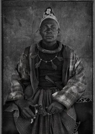 Himba Headman Holding MP3 Player, near Ehomba, Namibia, 2011.